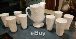Milk glass pitcher and 8 matching glasses, vintage grape and leaf motif